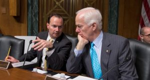 Sen. Mike Lee, R-Utah, left, confers with Sen. John Cornyn, R-Texas. on Capitol Hill in Washington in March. Republicans, including Cornyn and Lee, had joined forces with Democrats in hopes of revising the 1980s and '90s-era federal 'tough on crime' laws by reducing some mandatory sentences for low-level drug offenders and giving judges greater discretion in sentencing. (J. Scott Applewhite/AP file photo)