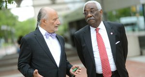 William H. 'Billy' Murphy Jr., left, talks with J. Howard Henderson, president and CEO of the Greater Baltimore Urban League, outside the Baltimore Convention Center on Friday during the National Urban League's conference. Murphy urged for ending of the drug war by treating addiction as a medical issue instead of a criminal one. (Maximilian Franz/The Daily Record)