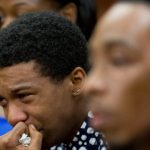 Marquez Tolbert cries Tuesday as he listens in Atlanta to testimony in the trial of Martin Blackwell, who was accused of pouring boiling water on him and a friend Anthony Gooden, right, as they slept. A jury on Wednesday found Blackwell guilty of eight counts of aggravated battery and two counts of aggravated assault for the February attack. (John Bazemore/AP photo)