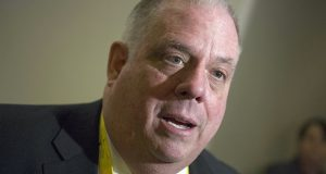 In this Sunday, Feb. 21, 2016 file photo, Maryland Gov. Larry Hogan speaks with a reporter during the National Governors Association Winter Meeting in Washington. (AP Photo/Cliff Owen, File)