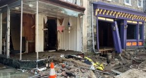 Damage along Main Street in Ellicott City as seen Monday. Maryland Insurance Administration Commissioner Al Redmer Jr. says he is not surprised many business owners did not have flood insurance after speaking with many during a town hall meeting Monday afternoon. 'A number of people explored flood insurance and they made the informed decision not to buy it,' he says. 'In their view they felt it was expensive.' (Juliet Linderman/AP Photo)