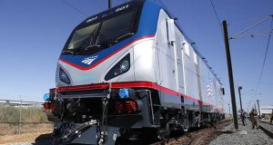 FILE- In this May 13, 2013, file photo one of the new Amtrak Cities Sprinter Locomotive makes a demonstration run during unveiling ceremonies at the Siemens Rails Systems factory in Sacramento, Calif. The introduction of 70 new locomotives on Amtrak's most heavily traveled line three years ago has contributed to a reduction in engine-related delays of nearly 25 percent, the national passenger railroad said Thursday, Aug. 4, 2016. (AP Photo/Rich Pedroncelli, File)