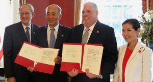 Gov. Larry Hogan, second from right, and Japanese Ambassador to the United States Kenichiro Sasae, second from left, pose for a photo as they sign a Memorandum of Cooperation between Maryland and Japan at the Maryland governor's residence in Annapolis, Md., Wednesday, Aug. 24, 2016. The ambassador said Japan has authorized $2 million to help study building a high-speed magnetic-levitation train between Washington and Baltimore. Maryland first lady Yumi Hogan is standing far right. Maryland Secretary of State John Wobensmith is standing far left. (AP Photo/Brian Witte)