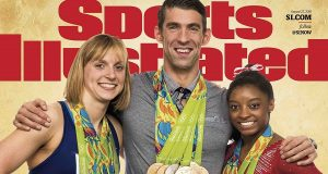 This image provided by Sports Illustrated shows the cover for the Aug. 14, 2016, issue of the magazine, featuring American gold medal winners Katie Ledecky, left, Michael Phelps, center, and Simone Biles. The magazine revealed the cover on its website Tuesday, Aug 16, 2016, says the photo was taken Sunday, Aug. 14, at the Olympics in Rio de Janeiro, Brazil. (Simon Bruty/Sports Illustrated via AP) MANDATORY CREDIT