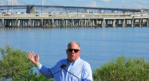 Gov. Larry Hogan speaks at a news conference on Tuesday, Aug. 30, 2016 near Annapolis, Md., with the Chesapeake Bay Bridge in the backdrop. Hogan announced a $5 million study to explore a potential new Chesapeake Bay crossing. (AP Photo/Brian Witte)