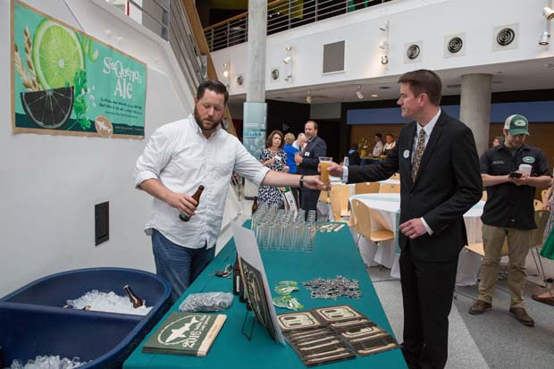 Attendees of the National Aquarium's 35th anniversary party were invited to taste the new SeaQuench Ale from Dogfish Head Brewery, the official craft brewery of the aquarium. (National Aquarium photo)