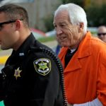 Former Penn State University assistant football coach Jerry Sandusky, right, arrives at the Centre County Courthouse for an appeals hearing about whether he was improperly convicted four years ago, in Bellefonte, Pa. Friday, Aug. 12, 2016. Sandusky plans to take the stand and try to prove his claim he was wrongly convicted four years ago of sexually abusing 10 boys. (AP Photo/Gene J. Puskar)