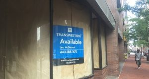 Commercial retail space in Baltimore, like this vacancy at Baltimore and Charles streets, could be harder to fill if the minimum wage is raised to $15, some brokers and experts say. (Adam Bednar)