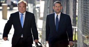 David Wildstein, right, former Port Authority appointee of New Jersey Gov. Chris Christie, arrives at the Martin Luther King Jr. Federal Courthouse with his attorney Alan Zegas, left, on Monday. Wildstein testified Tuesday that Christie was happy about the major traffic jam in 2013 on the George Washington Bridge, which prosecutors allege was done as political payback against a Democratic mayor for not endorsing the governor. (Amy Newman/The Record of Bergen County via AP)