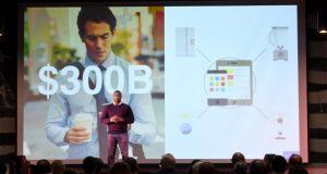 Luke Cooper, founder and CEO of fixt, speaks while giving the company's product pitch at BetaCity 2016. (Maximilian Franz/The Daily Record)
