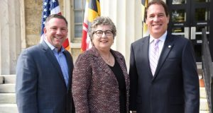 From left, Ken Ulman, former Howard County executive and president of Margrave Strategies: Kim Schatzel, president of Towson University; and Kevin Kamenetz, Baltimore County executive, at the announcement of Ulman's role with helping shape growth strategies for Towson University. (Maximilian Franz / The Daily Record)