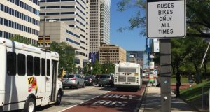 A Maryland Transit Administration bus heads east on Pratt Street on a designated bus lane. Transportation activists released a report Thursday arguing plans to overhaul the Baltimore metro area's bus routes are inadequate. (Adam Bednar/The Daily Record)