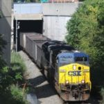 A CSX trains comes out of the south end of the Howard Street Tunnel near the stadiums. (File photo)