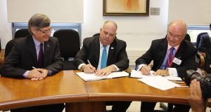 Tel Aviv University Vice President Raanan Rein, left, Md. Gov. Larry Hogan, center, and UMBC Vice Provost for Academic Affairs Antonio Moreira sign a memorandum of understanding between the two schools in Israel Sept. 21, 2016. (Photo from the Office of Governor Larry Hogan)
