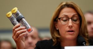 Mylan CEO Heather Bresch holds up an EpiPen while testifying on Capitol Hill in Washington, Wednesday, Sept. 21, 2016, before the House Oversight Committee hearing on EpiPen price increases. Bresch defended the cost for life-saving EpiPens, signaling the company has no plans to lower prices despite a public outcry and questions from skeptical lawmakers. (AP Photo/Pablo Martinez Monsivais)