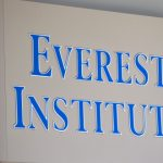 In this July 8, 2014 file photo, an Everest Institute sign is seen in a office building in Silver Spring, Md. The Education Department withdrew recognition of the nation's largest accreditor of for-profit colleges on Sept. 22, 2016, a decision that could force schools to close and threaten financial aid to hundreds of thousands of students.  (AP Photo/Jose Luis Magana, File)