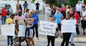 Demonstrators protest police treatment of a 15-year-old girl who was pepper-sprayed during an arrest Wednesday in Hagerstown. Police pepper-sprayed a 15-year-old girl and charged her as a juvenile with assault and disorderly conduct after her bicycle hit a car, prompting disagreement Wednesday about whether the officers acted properly.(Ric Dugan/The Herald-Mail via AP)