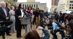 Baltimore City State's Attorney Marilyn J. Mosby announces charges against six officers in connection with the death of Freddie Gray in May 2015. Five of the officers have alleged in civil suits that Mosby defamed them during her press conference. Mosby has denied the allegation and argues she was simply reading the statement of charges to the public. (File photo)
