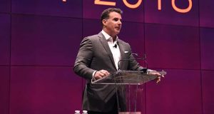 Kevin Plank, speaking at a stockholders meeting in 2016 with a slide behind him that shows that the company is projecting $7.5 billion in revenue by 2018. (Maximilian Franz)
