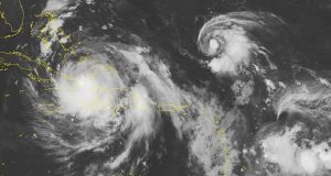 This NOAA satellite image taken Wednesday, Oct. 05, 2016 at 12:45 AM EDT shows both current active tropical cyclones in view moving away from the Caribbean, with Hurricane Matthew north of the eastern edge of Cuba, and Tropical Storm Nicole located out over the western Atlantic to the northeast of Matthew. Matthew is currently at category 4 strength with maximum sustained winds up to 125 MPH. Matthew will continue to move northward away from the Caribbean, though its outer bands are still impacting Hispaniola, and Haiti continues to bear the full impact of Matthew with heavy rains and strong winds. (NOAA/Weather Underground via AP)