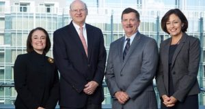 From left, Jennifer P. Keller, Baker Donelson president and chief operating officer; Ben C. Adams, Baker Donelson chairman and chief executive officer; S. Craig Holden, Ober|Kaler chairman and chief executive officer; and Darlene R. Davis, Ober|Kaler president and chief operating officer. The two firms will combine under the name of Baker Donelson on Jan. 1. (Photo provided)