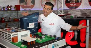 "TLC's ""Cake Boss"" Buddy Valastro unveils a giant specialty cake replica of the new $200M flagship Live! Hotel tower, currently under construction at Live! Casino, located in the Washington DC/Baltimore corridor. Live! Hotel is scheduled to open in 1st quarter 2018. (PRNewsFoto/Live! Casino and Hotel)"