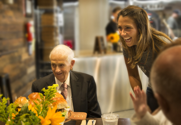 """J. W. """"Bill"""" Marriott Jr., the executive chairman and chairman of the board of Marriott International Inc., shares a laugh with Megan Lanasa, owner of BricknFire Pizza Co."""