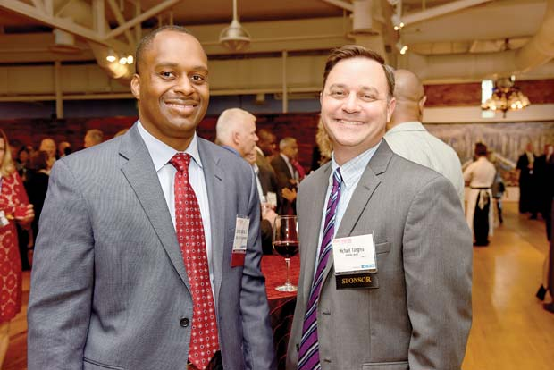 Samuel Johnson Jr., left, of the Baltimore City Fire Department, and Michael Tangrea of LifeBridge Health, attended the Daily Record's 2016 Innovators of the Year event. (The Daily Record / Maximilian Franz)