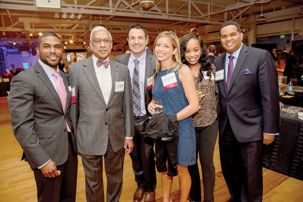 From left, Dr. S. Dallas Dance, the superintendent of Baltimore County Schools; AKM Shamsuddin, from the University of Maryland; Tim and Julie Polanowski, of At Night Athletics, Jenelle Turner; and Mychael Dickerson, of Baltimore County Schools, take time for a photo at the American Visionary Art Museum in Federal Hill. (The Daily Record / Maximilian Franz)