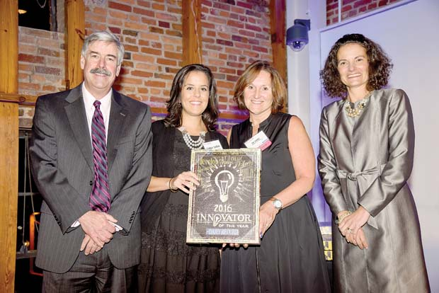 Candice Stafford and Pat Goldys, center left and right, won for their work with the Norwood Stem program, which brings a bus of science-related activities into the neighborhoods served by Dundalk's Norwood Elementary School. They are pictured with Daily Record Editor Thomas Baden, left, and Publisher Suzanne Fischer-Huettner. (The Daily Record / Maximilian Franz)