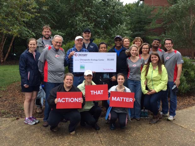 Crosby Marketing Communications employees display a $5,000 check presented to the Chesapeake Ecology Center during its day of service. (Crosby Marketing Communications photo)