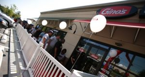 08.17.11 TOWON, MD.  A long line of customers wait to grab lunch at the recently opened Gino's in Towson, Md. Wednesday Aug. 17, 2011. The Daily Record/Rich Dennison)
