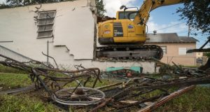 Demolition equipment destroys a vacant property in the predominantly minority neighborhood known as Model City in Miami on Nov. 1. The U.S. Supreme Court on Tuesday considered whether the city could sue big banks under the Fair Housing Act for targeting mostly minority neighborhoods with predatory lending practices. (Photo for The Washington Post by Angel Valentin)