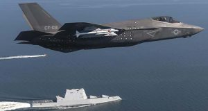 An F-35 Lightning II flies over the USS Zumwalt in the Chesapeake Bay in Maryland, Oct. 17, 2016. (U.S. Navy photo / Andy Wolfe)