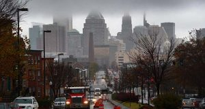 Low hanging clouds shrouded the top floors of Baltimore's tallest buildings yesterday, bringing with it some much-needed rain and above-normal temperatures for late November, peaking in the low 60s. (The Daily Record/Maximilian Franz)