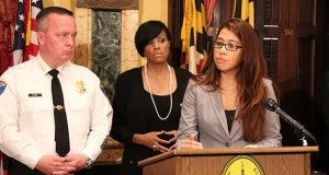 """rom left Baltimore Police Commissioner Kevin Davis and Mayor Stephanie Rawlings-Blake and Catalina Rodriguez-Lima, director of the Mayor's Office of Immigration and Multicultural Affairs, speaks during a news conference announcing Baltimore will remain a """"welcoming city."""" (The Daily Record/ Adam Bednar.)"""