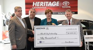 "11-16-2016 CATONSVILLE, MD- From left, Dave Gruner, General Manager of Heritage Toyota Catonsville; Constantine Spivak, Division President of Baltimore Region for Mile One; Maureen Sweeney Smith- Executive Director of the Ellicott City Partnership; andHoward County Howard County Executive Alan Kittleman holding a giant check during the special ceremony to award funds to those who lost their vehicles during the flood in July. In October, Heritage Toyota Catonsville launched ""On The Road"" in which residents, property owners, business owners and employees who lost their vehicles in the flood could apply for financial relief from a $50,000 fund established by Heritage Toyota Catonsville. The $50,000 was divided between 43 people who qualified by showing their vehicles were claimed as a total loss and they lived within the area of historic Ellicott City.  (The Daily Record/ Maximilian Franz)."