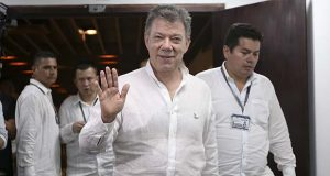 FILE - In this Oct. 29, 2016 file photo, Colombia's President Juan Manuel Santos waves during the 25th Ibero-American Summit in Cartagena, Colombia. (AP Photo/Fernando Vergara, File)