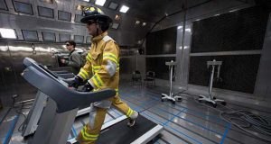 A firefighter walks on a treadmill in the environmental chamber at W. L. Gore and Associates' new biophysics and heat and flame protection labs in Elkton, Cecil County. (W. L. Gore & Associates photo)