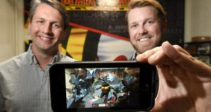 11.23.2016 Baltimore, MD- Will Gee, CEO and Shawn Patrick Flaherty, COO of Balti Virtual, seen here with their Holotats app showing the Maryland Terps mascot breaking through the wall in their office at City Garage in Port Covington.  (The Daily Record/Maximilian Franz)