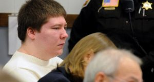 In this Jan. 19, 2010 file photo, Brendan Dassey, left, listens to testimony at the Manitowoc County Courthouse in Manitowoc, Wis.