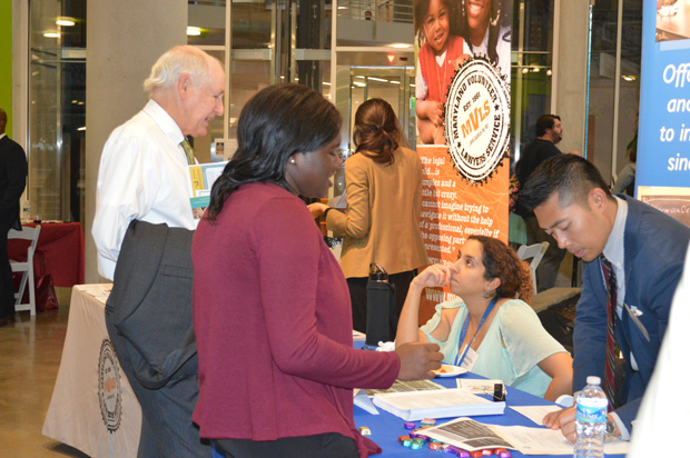 Pro Bono Connection fair attendees talk with representatives at the Esperanza Center information table. (Submitted photo by Elizabeth Grove)
