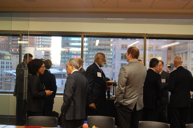 Attendees at the Equal Justice Council of Maryland Legal Aid's 10th annual managing partners meeting enjoy some mingling time and light conversation.  (Ashley Fails submitted photo)