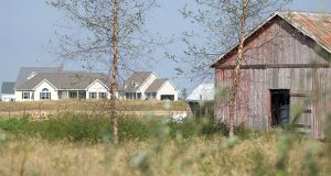 Shot of an old barn with a new housing development in the background. taken along the road in Queen Annes County on the eastern shore. MF-D 10/5/04