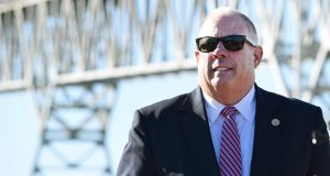 Governor Hogan stands in front of the Harry Nice bridge. (The Daily Record / Bryan P. Sears)