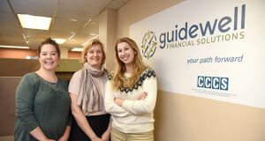 From Left, Devon Hyde, Director of Business Development; Helene D. Raynaud, President/CEO; and Victoria Cron, intern at Guidewell Financial Services. (The Daily Record/Maximilian Franz)