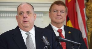 Gov. Larry Hogan, left, speaks as Transportation Secretary Pete Rahn listens on Wednesday. (The Daily Record / Bryan P. Sears)
