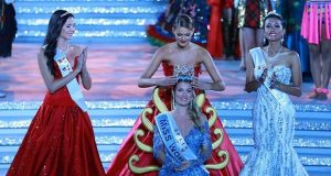 Rolene Strauss of South Africa crowns her successor, Mireia Lalaguna of Spain, at Miss World 2015, held in Sanya, China. (Miss World Organization photo)
