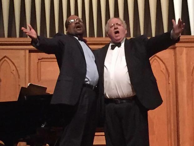 "Judge Michael Reed, left, and Judge Charles Shubow belt out ""Brotherhood of Man,"" from the musical ""How to Succeed in Business"" during the Cabaret and Cabernet fundraising event for Senior Legal Services. (Submitted photo by Katherine T. Sanzone)"