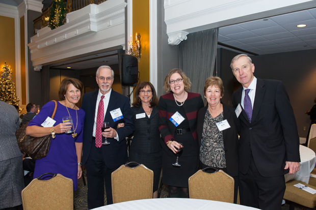 From left, Cindi Monahan with Gordon Krabbe, who accepted an award for the Enoch Pratt Free Library, pose fo a photo with MLSC Executive Director Susan Erlichman, awardee Amy Petkovsek of Maryland Legal Aid and her parents, Ann and Bob Petkovsek. (Guill Photo Inc. submitted photo)